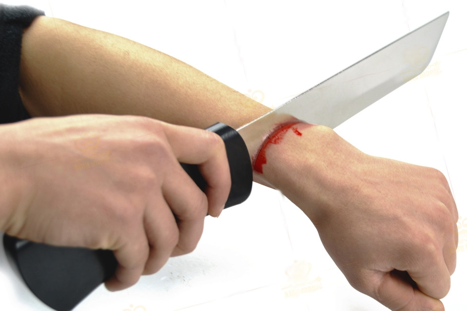 Knife Through Arm with blood